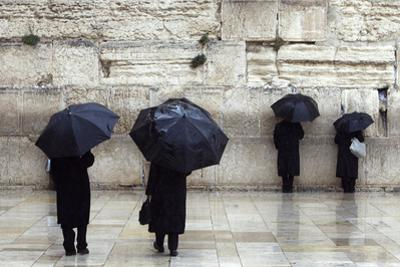Jewish Worshippers Hold Umbrellas on a Rainy Day