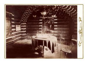 Room Made of Wine Bottles with Table
