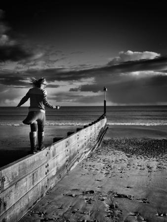 Girl Walking on Sea Defence by Rory Garforth