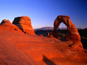 Delicate Arch and Surrounding Slick-Rock with La Sal Mountains in Distance, Utah by Ross Barnett