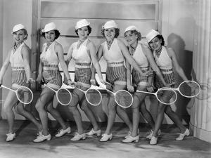 Row of Female Tennis Players in Matching Outfits