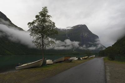 https://imgc.allpostersimages.com/img/posters/rowing-boats-lake-mountains-and-low-cloud-lovatnet-lake-norway-scandinavia-europe_u-L-PQ8RSN0.jpg?p=0