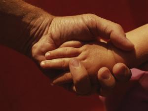 A Father Holds His Daugters Small Hand by Roy Gumpel