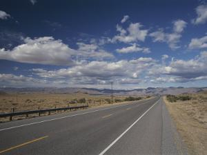 A Scenic of Route 40 Passing Through an Arizona Desert by Roy Gumpel