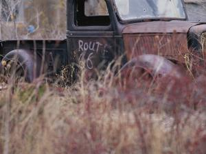 An Abandoned Old Truck Sits in a Field of Autumn Colored Grasses by Roy Gumpel
