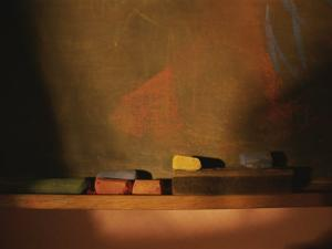 Colored Chalk Lies in a Tray on a Blackboard by Roy Gumpel