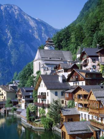 Houses, Chalets and the Church of the Village of Hallstatt in the Salzkammergut, Austria by Roy Rainford