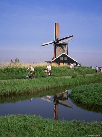 People Riding Bicycles, Zaanse Schans, Near Amsterdam, Holland by Roy Rainford