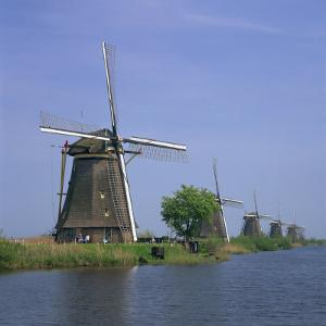 Windmills on the Canal at Kinderdijk Near Rotterdam, UNESCO World Heritage Site, the Netherlands by Roy Rainford