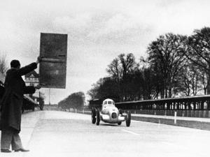Rudolf Caracciola Driving Mercedes-Benz W25 Streamliner Car, 1934