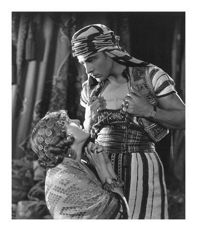 https://imgc.allpostersimages.com/img/posters/rudolph-valentino-the-son-of-the-sheik-with-vilma-banky_u-L-F92V450.jpg?artPerspective=n