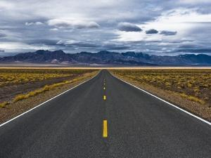 Empty Highway in Death Valley National Park by Rudy Sulgan