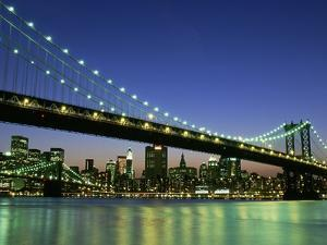 Manhattan Bridge Spanning the East River by Rudy Sulgan