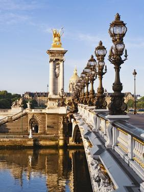 Pont Alexandre-III and Dome des Invalides over Seine river by Rudy Sulgan