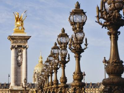 Pont Alexandre-III and Dome des Invalides by Rudy Sulgan