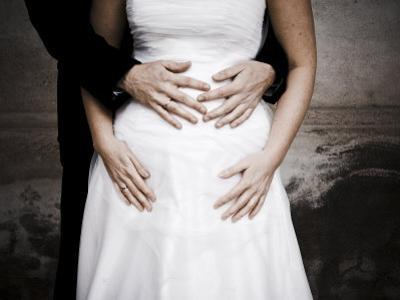 Wedding Couple with Groom's Hands on Brides Stomach