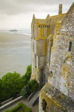 Abbey walls and bay, Mont Saint-Michel monastery, Normandy, France by Russ Bishop
