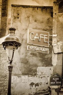 Cafe sign and lamp post, Paris, France by Russ Bishop