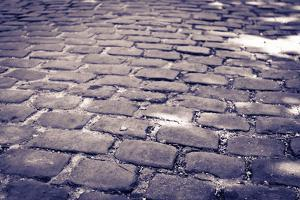 Cobblestone walkway at Pere Lachaise Cemetery, Paris, France by Russ Bishop