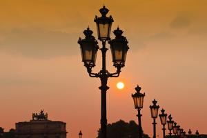 Lamp posts at sunset, Louvre Museum, Paris, France by Russ Bishop