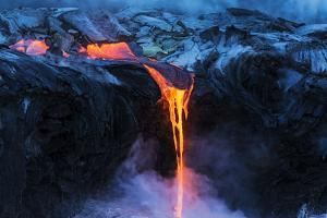 Lava flow entering the ocean at dawn, Hawaii Volcanoes National Park, The Big Island, Hawaii, USA. by Russ Bishop