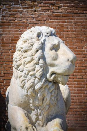 Lion statue at the entrance to the Arsenal, Venice, Veneto, Italy by Russ Bishop