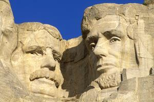 Morning light on Lincoln and Roosevelt detail, Mount Rushmore National Memorial, South Dakota, USA. by Russ Bishop