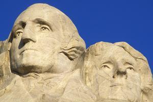 Morning light on Washington and Jefferson detail, Mount Rushmore National Memorial, South Dakota by Russ Bishop