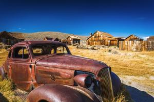 Rusted car and buildings, Bodie State Historic Park, California, USA by Russ Bishop