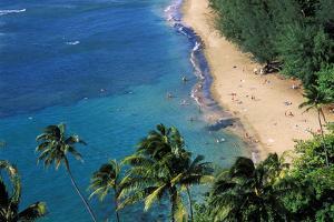 Sunbathers and blue Pacific waters at Ke'e Beach, North Shore, Island of Kauai, Hawaii, USA. by Russ Bishop