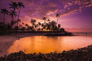 Sunset over Pu'Uhonua O Honaunau National Historic Park, Kona Coast, Hawaii by Russ Bishop