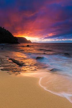 Sunset over the Na Pali Coast from Hideaways Beach, Princeville, Kauai, Hawaii by Russ Bishop