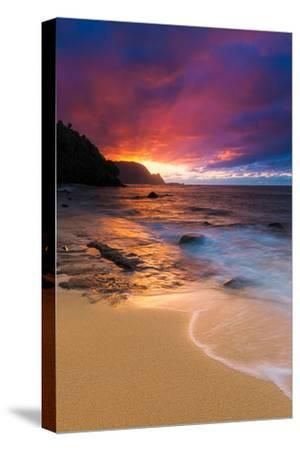 Sunset over the Na Pali Coast from Hideaways Beach, Princeville, Kauai, Hawaii by Russ Bishop