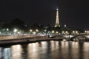 The Eiffel Tower at night from the Seine River, Paris, France by Russ Bishop