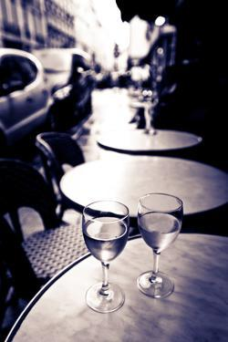 Wine Glasses at an Outdoor Cafe, Paris, France by Russ Bishop