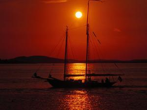 Silhouetted Sailboat, Rockport, Maine by Russell Burden
