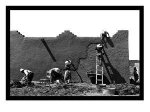 Spanish-American Women Replastering an Adobe House by Russell Lee