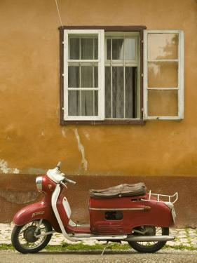 Red Moped, Sighisoara, Transylvania, Romania by Russell Young