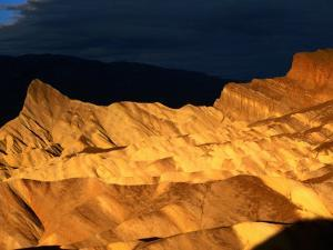 Dawn Light Over Zabriskie Point Yellow-Tinted Rock Formation, Death Valley National Park, U.S.A. by Ruth Eastham