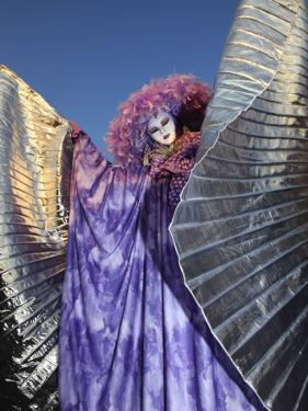 Masked Person in Costume with Silver Wings Near St.Mark's Square by Ruth Eastham & Max Paoli