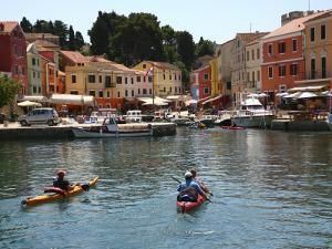 People in Kayaks Approaching Veli Losinj Harbour by Ruth Eastham & Max Paoli