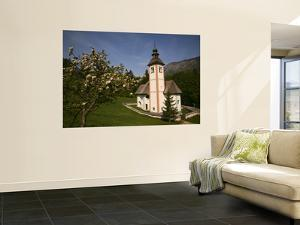 The Holy Spirit Church with Apple Tree in Blossom, Near Southern Shore of Lake Bohinj by Ruth Eastham & Max Paoli