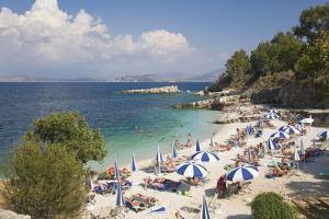 Beach Crowded with Holidaymakers, Kassiopi, Corfu, Ionian Islands, Greek Islands, Greece, Europe by Ruth Tomlinson