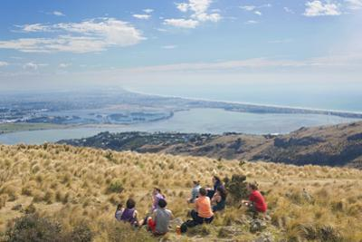 Group of young people enjoying a picnic on the Port Hills, Christchurch, Canterbury, South Island,