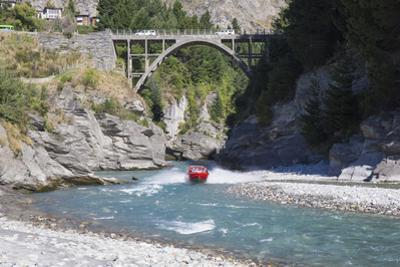 Jet boat on the Shotover River below the Edith Cavell Bridge, Queenstown, Queenstown-Lakes district