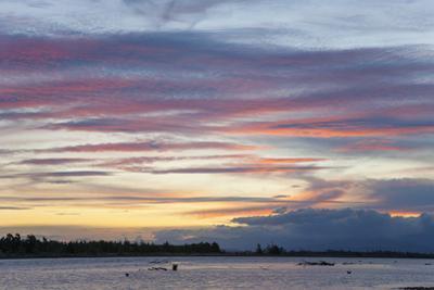 Pink clouds over the Wairau River estuary at dusk, Wairau Bar, near Blenheim, Marlborough, South Is