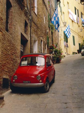 Red Car Parked in Narrow Street, Siena, Tuscany, Italy