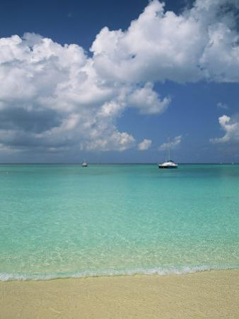 Still Turquoise Sea off Seven Mile Beach, Grand Cayman, Cayman Islands, West Indies by Ruth Tomlinson