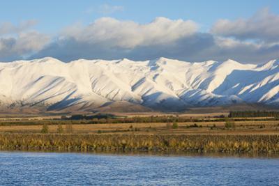 The Ben Ohau Range cloaked in autumn snow, the Pukaki Canal in foreground, Twizel, Mackenzie distri