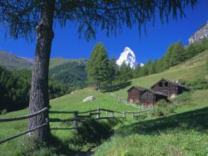The Matterhorn Towering Above Green Pastures and Wooden Huts, Swiss Alps, Switzerland by Ruth Tomlinson